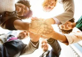 business people hands together